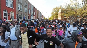 Baltimore, Md.--4/21/15--About 600 protestors including the families of Freddie Gray protested Gray's death while in the custody of Baltimore police by marching from the site of the arrest, the corner of N. Mount and Presbury streets, to the Western District station about six blocks away.  Kenneth K. Lam/Baltimore Sun   DSC_8718  md-freddie-gray-p9-folder lam ORG XMIT: BAL1504212005444308