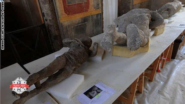 A picture shows petrified victims of the eruption of Vesuvius volcano in 79 BC، during the restoration work and the study of 86 casts in the laboratory of Pompeii Archaeological Site، on May 20، 2015 in Pompeii. AFP PHOTO / MARIO LAPORTA  (Photo credit should read MARIO LAPORTA/AFP/Getty Images)