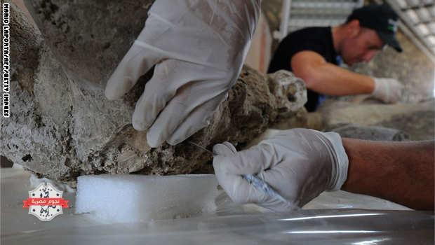 A restorer works on a petrified victim of the eruption of Vesuvius volcano in 79 BC، as part of the restoration work and the study of 86 casts in the laboratory of Pompeii Archaeological Site، on May 20، 2015 in Pompeii. AFP PHOTO / MARIO LAPORTA  (Photo credit should read MARIO LAPORTA/AFP/Getty Images)