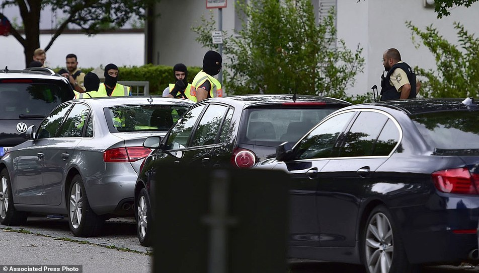 Police officer search a residential area near the Olympia shopping centre after a shooting was reported there in Munich، southern Germany، Friday، July 22، 2016. Several people have been reported to be killed. (AP Photo/Marc Kleine-Kleffmann)