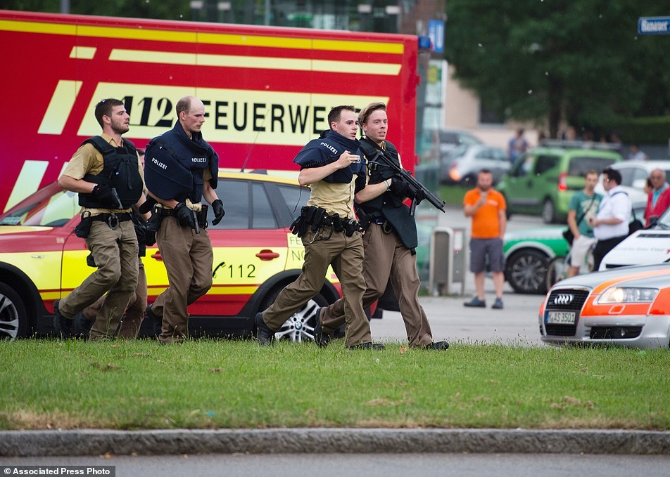Policemen arrive at a shopping centre in which a shooting was reported in Munich، southern Germany، Friday، July 22، 2016. Situation after a shooting in the Olympia shopping centre in Munich is unclear. (Matthias Balk/dpa via AP)