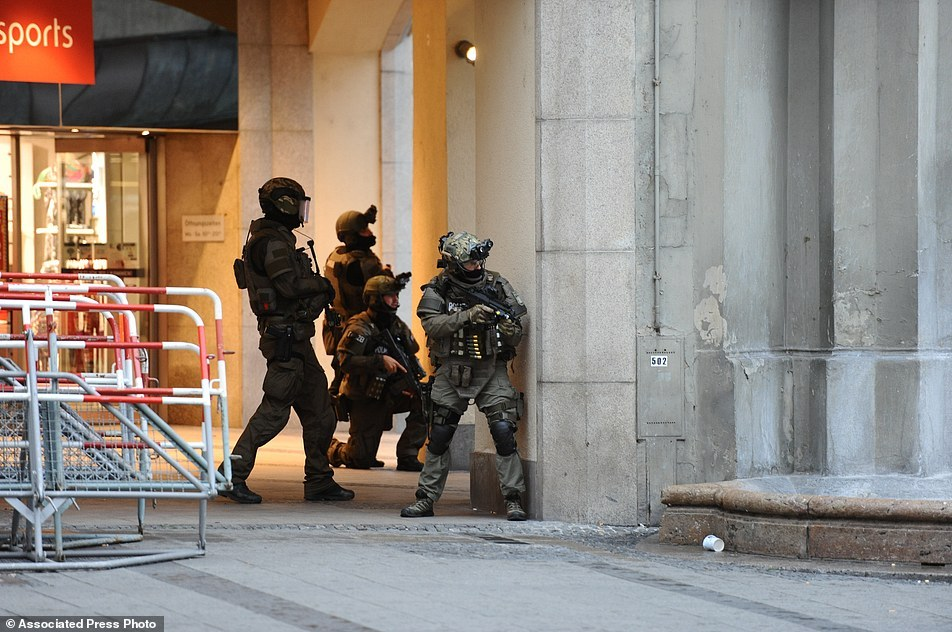 Heavily armed police forces operate at Karlsplatz (Stachus) square after a shooting in the Olympia shopping centre was reported in Munich، southern Germany، Friday، July 22، 2016. (Andreas Gebert/dpa via AP)